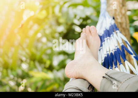 close up man in a hammock on vacation day relax time ,warm retro filter effect - Stock Photo