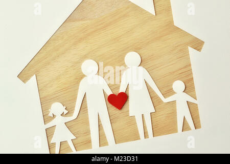 Paper family cut-out and house - Love and family union concept - Stock Photo