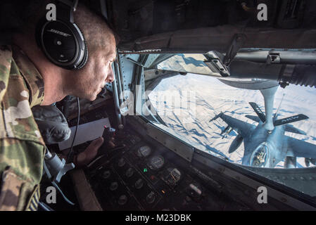 U.S. Air Force Tech. Sgt. Daryl Gladstein, a boom operator assigned to the 340th Expeditionary Air Refueling Squadron, - Stock Photo