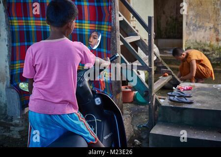 Camboadian boy and little Buddhist Monk in buddhist monestry, Battambang, Cambodia - Stock Photo