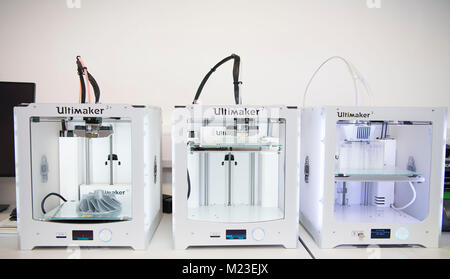 A Ultimaker 2 3d digital printer in use in a laboratory. - Stock Photo