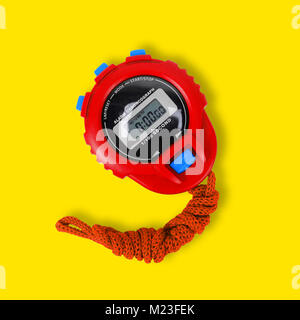 Sports equipment - Red Digital electronic Stopwatch on a yellow background. - Stock Photo