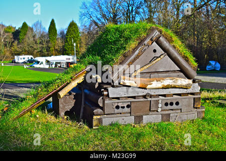 Insect Hotel at Caravan Club site in Tredegar House Country Park near Newport S.Wales. Built to attract a  wide - Stock Photo