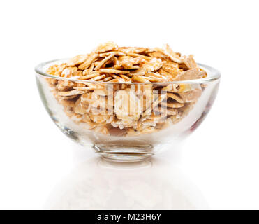 Dry rolled oatmeal in bowl, isolated on white background. - Stock Photo