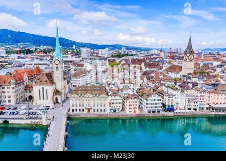 Zurich, Switzerland. View of historic Zurich city center with famous Fraumunster Church, Limmat river and Zurich - Stock Photo