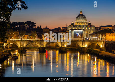 Vatican City and Saint Angelo Bridge at dusk, Italy - Stock Photo