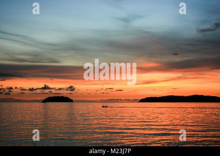 Sunset off Tanjung Aru, Kota Kinabalu, Sabah, Malaysia - Stock Photo