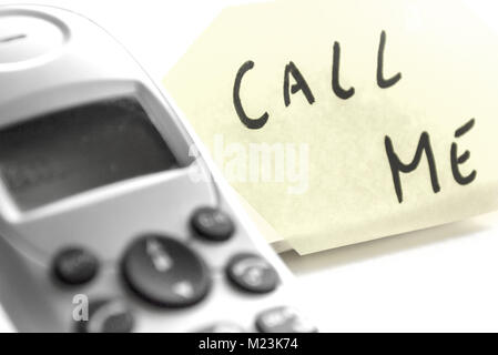 Call Me Note and Phone - Stock Photo
