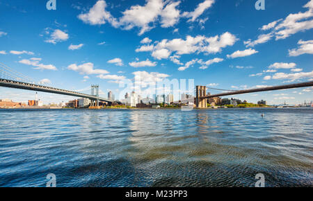 Manhattan and Brooklyn bridge over East rver, View to Brooklyn from Manhattan, New York City - Stock Photo