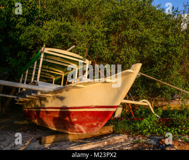 A wooden boat at sunset in Lombok Island, Indonesia. - Stock Photo