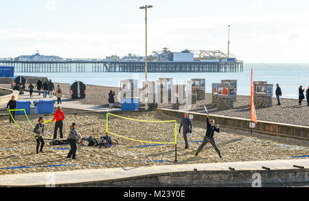 Brighton UK 4th February 2018 - Beach tennis players enjoy a beautiful sunny day on Brighton seafront today with - Stock Photo