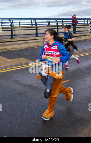 Southport, Merseyside. 4th February, 2018.  The seventh Mad Dog 10k race runners turning up in fancy dress. Southport's - Stock Photo