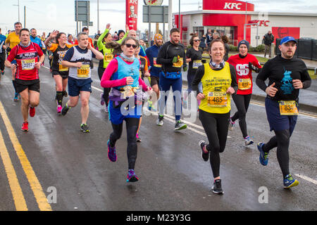 Southport, Merseyside. 4th February, 2018.  The seventh Mad Dog 10k race with runners turning up in fancy dress. - Stock Photo