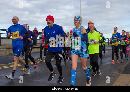 Southport, Merseyside. 4th February, 2018.  The seventh Mad Dog 10k race.with runners turning up in fancy dress. - Stock Photo