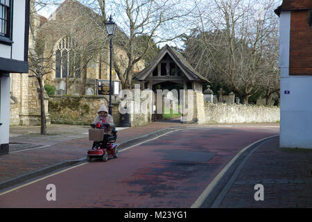 Edenbridge,UK,4th February 2018,Bright and sunny day in Edenbridge, Kent. A lady rides on her mobility scooter despite - Stock Photo