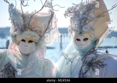 Venice Carnival 2018. After the opening event of the flying angel, Masks posing near Piazza San Marco. Venice, Italy. - Stock Photo