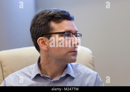 Seattle, Washington: Bob Ferguson listens to Carlos Rodriguez speak during the 'The Fate of the DREAMers' panel - Stock Photo