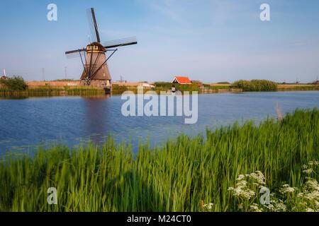 Netherlands kinderdijk historic windmill at a lake - Stock Photo