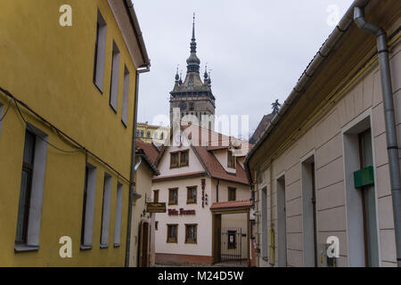 Sighisoara, Romania - 30.12.2017: The clock tower of Sighisoara viewed from a street in the old town - Stock Photo