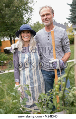 Portrait smiling senior couple gardening - Stock Photo