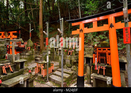 Thousands of small private worship Shinto shrines, Tsuka, at Fushimi Inari-Taisha head shrine in Fushimi Ward, Kyoto, - Stock Photo
