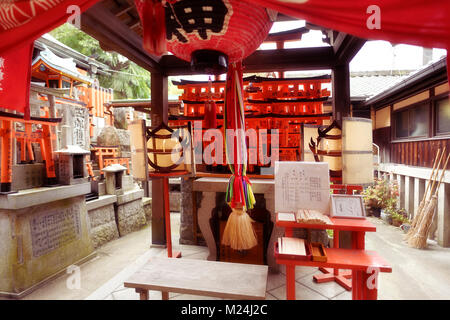One of the side Shinto shrines at Fushimi Inari Taisha head shrine in Fushimi Ward, Kyoto, Japan - Stock Photo