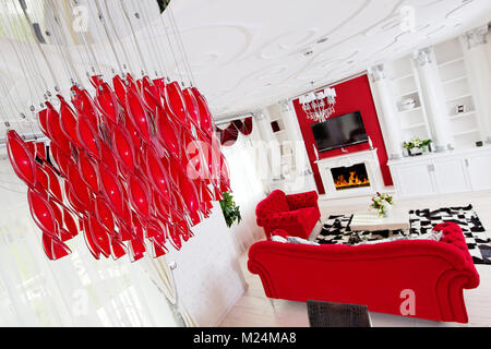 Classical red living room interior with fire place and ceiling design - Stock Photo