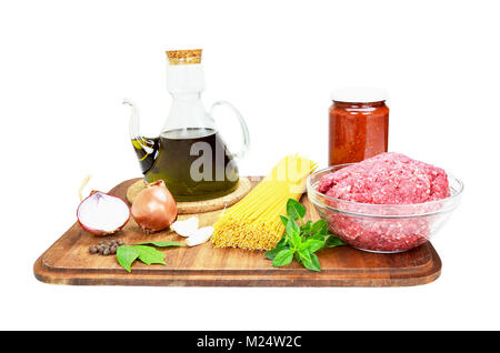Ingredients of spaghetti Bolognese isolated on white - Stock Photo