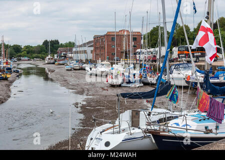 Small boats and sailing yachts moored in the River Medina, Newport, Isle of Wight, Hampshire, England, UK - Stock Photo