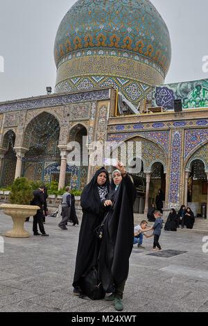 Tehran, Iran - April 27, 2017: Iranian women in hijab take pictures of themselves near the Shrine of Hazrat Abdulazim - Stock Photo