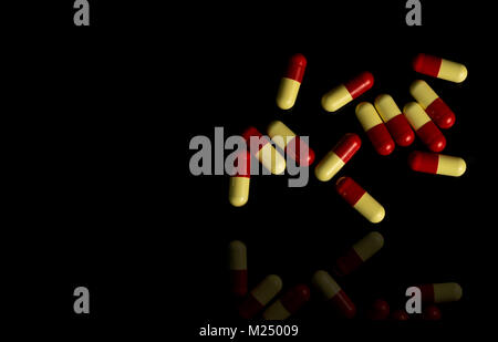 Red, yellow capsule pills on dark background. Antimicrobial resistance concept. - Stock Photo