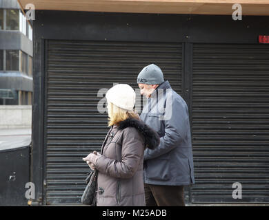 London,UK,5TH February 2018,Dull, cold and miserable by London Bridge in London. People wrap up warm against the - Stock Photo