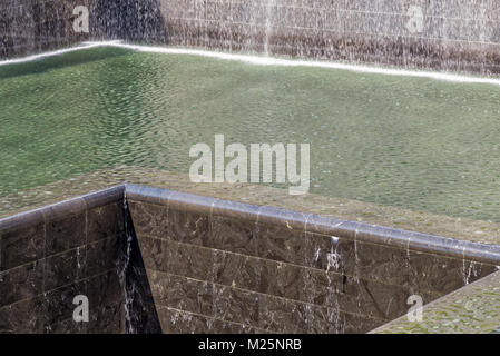 New York, USA - June 08, 2015: South pool memorial commemorating the victims of the 11 september terror attack in - Stock Photo