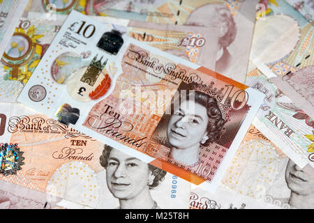 new polymer 10 quid notes with soon to be phased out paper 10 pound notes in the uk - Stock Photo