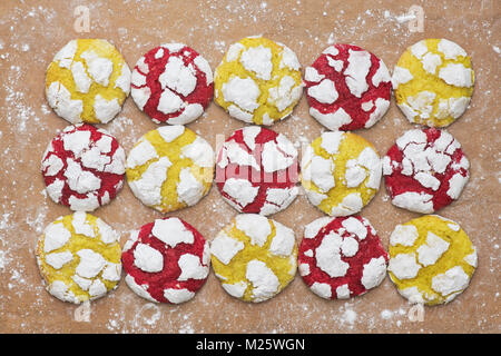 Homemade Lemon and Raspberry Crinkle Cookies on a baking sheet. UK - Stock Photo