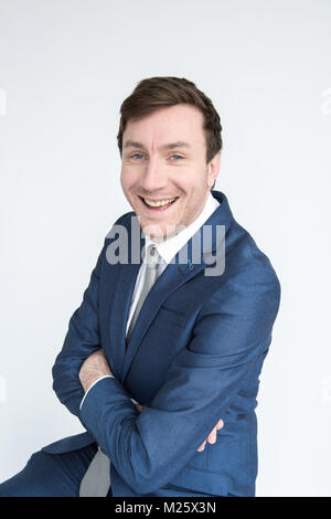 portrait of smartly dressed smiling man with folded arms looking into camera. Isolated on white background - Stock Photo