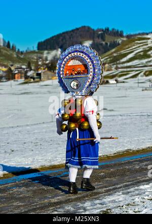 Beautiful Chlaus with ornate embroidered headgear at Old Sylvester, Urnäsch, Canton Appenzell Ausserrhoden, Switzerland - Stock Photo