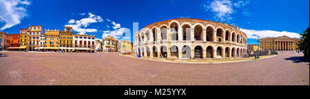 Roman amphitheatre Arena di Verona and Piazza Bra square panoramic view, landmark in Veneto region of Italy - Stock Photo