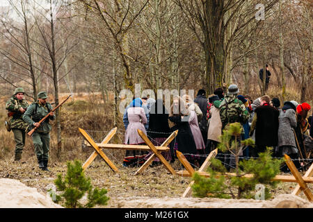 Gomel, Belarus - November 26, 2016: German soldiers guard the captives of civilians. Reconstruction of the Liberation - Stock Photo