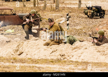 Gomel, Belarus - November 26, 2016: The offensive of Soviet soldiers through trenches. reconstruction of the battles - Stock Photo