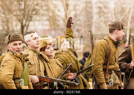 Gomel, Belarus - November 26, 2016: Soviet soldiers of the red army stand in line after the battle to assimilate - Stock Photo
