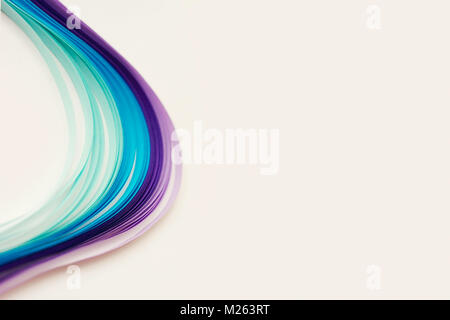 Shades of blue and violet paper stripes on white background; abstract lines background Stock Photo