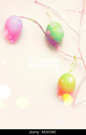 Colorful easter eggs on white branch, with glitter and copy space - Stock Photo