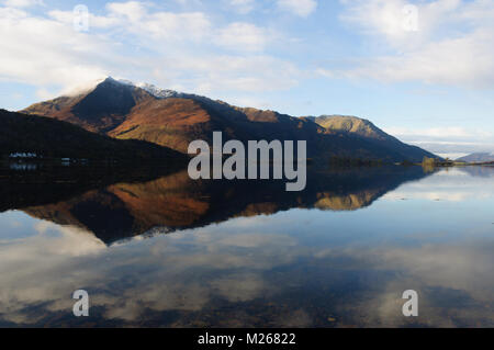 Beinn a'Bheithir reflected in Loch Leven on a cold, bright, still November morning, from Invercoe near Glencoe, - Stock Photo