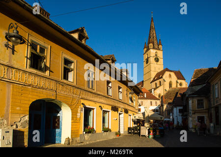 Sibiu - Romania, July 18, 2017: Transylvania. Lutheran Church, built in the Huet Square, seen from the streets of - Stock Photo