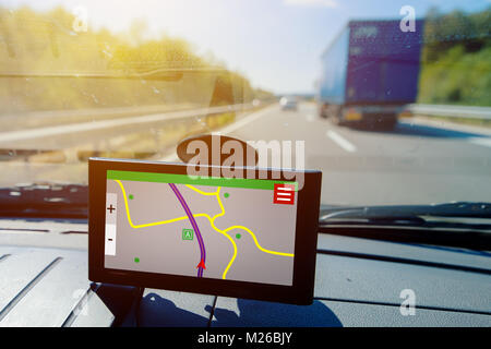 GPS (Global Positioning System) car navigation, help and assistance with direction on road - Stock Photo