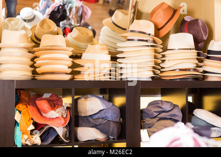 dfb97dde5e204d ... Stylish sun hats hanging on the shelf in the shopping store - Stock  Photo