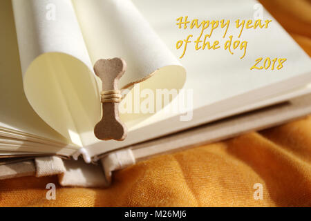 Happy year of the dog 2018 concept. Bone for dog. Happy New Year. Chinese new year 2018. Greetings card. - Stock Photo