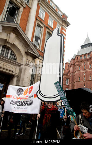 Demonstration called by the People's Assembly in support of the NHS . A giant cardboard condom is part of the Campaign - Stock Photo