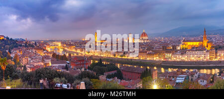 Famous view of Florence at night, Italy - Stock Photo